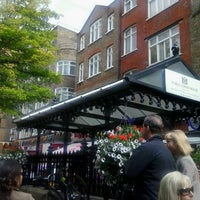 Photo taken at St Christopher's Place by Spyros G. on 7/15/2012