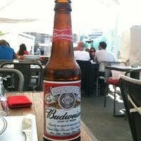 Photo taken at St. Elmo's  Seaside Brasserie by Zeynep S. on 4/23/2012