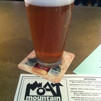 Photo taken at Moat Mountain Smoke House & Brewing Co. by Hollie C. on 8/10/2012