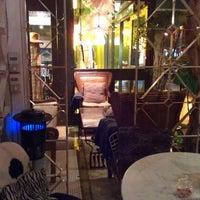 Photo taken at Khaki Cafe Bar by Willie C. on 3/9/2012