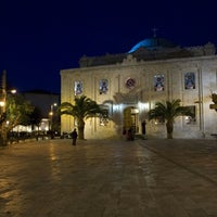 Photo taken at Saint Titos Square by Ioannis A. on 8/16/2012