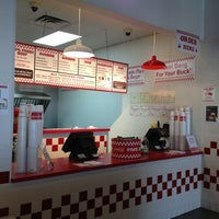 Photo taken at Five Guys by J W. on 3/11/2012