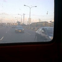 Photo taken at Third Mainland Bridge by Tope A. on 7/10/2012