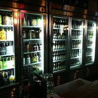 Photo taken at Brews Cafe by Ryan H. on 6/23/2012