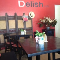 Photo taken at Delish Cafe by Adriano T. on 5/25/2012