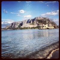 Photo taken at Spiaggia di Mondello by Alessandro C. on 7/24/2012