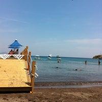 Photo taken at Parıltı Beach by Baris on 6/23/2012