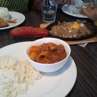 Photo taken at Turo-Turo Philippine Café by Greg O. on 3/24/2012