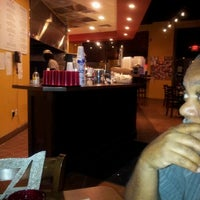 Photo taken at Oz Pizza by Heather G. on 6/10/2012