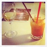 Photo taken at Black & White Cafe by Karina A. on 3/31/2012