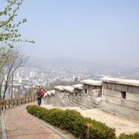 Photo taken at Naksan Park by Kanyasiri C. on 4/14/2012