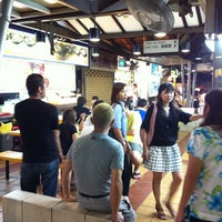 Photo taken at Chomp Chomp Food Centre by Ritthichai P. on 6/20/2012