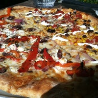 Photo taken at Flatbread Pizza Company by Stephanie K. on 9/1/2012
