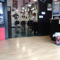 Photo taken at Sport Clips Haircuts of The Arbors at Mallard Creek by Jason E. on 5/22/2012