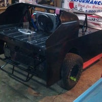 Photo taken at Masolini race shop by Dusty M. on 5/30/2012