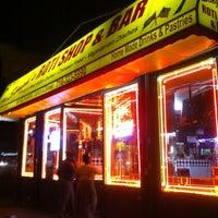 Photo taken at Singh's Roti Shop by Carlos R. on 7/28/2012