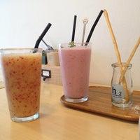 Photo taken at cafe  h 2 by jennifer y. on 7/21/2012