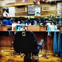 Photo taken at Juans Barber Shop by Binoy B. on 5/30/2012