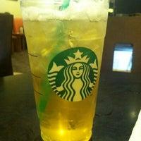 Photo taken at Starbucks by Jazmine H. on 4/18/2012
