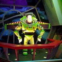 Photo taken at Buzz Lightyear's Space Ranger Spin by Alan G. on 5/13/2012