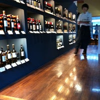 Photo taken at CERCLE wine & deli by Kiyomi T. on 4/22/2012