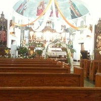 Photo taken at St Roman Church by Elizabeth F. on 4/20/2012