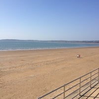 Photo taken at Swansea Bay Beach by Monica on 4/1/2012