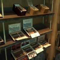 Photo taken at Highland Cigar Co. by Rawle F. on 8/23/2012