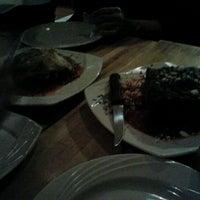 Photo taken at Thavma Mediterranean Grill by Edwin R. on 2/21/2012