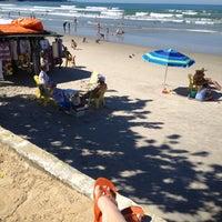 Photo taken at Praia Grande by Julia C. on 7/21/2012