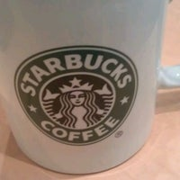 Photo taken at Starbucks by Finn W. on 3/12/2012