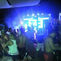 Photo taken at Paparazzi Beach Club by David D. on 3/4/2012
