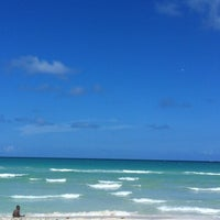 Photo taken at 75th Street Beach by Iván A. on 7/20/2012