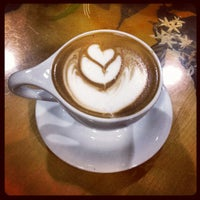 Photo taken at Portola Coffee Roasters by Shannon O. on 7/11/2012