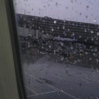 Photo taken at Gate B12 by Jimmy T. on 7/4/2012