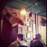 Photo taken at Burke's Pub by Eric D. on 3/17/2012