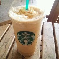 Photo taken at Starbucks by Alex Lee C. on 2/26/2012