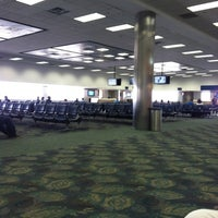 Photo taken at Gate D8 by Letitia C. on 5/21/2012