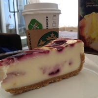 Photo taken at Starbucks by F E. on 9/12/2012