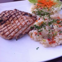 Photo taken at City Grill by Marcos K. on 5/21/2012