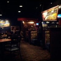 Photo taken at Boston Pizza by Nicolas P. on 5/12/2012