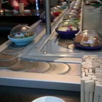 Photo taken at YO! Sushi by Laura G. on 7/20/2012