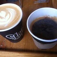 Photo taken at Flat Cap Coffee Co. by ekaphap d. on 8/5/2012