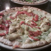 Photo taken at Brixx Wood Fired Pizza by LISA S. on 4/4/2012