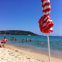 Photo taken at Plage de Pampelonne by Axel M. on 8/15/2012