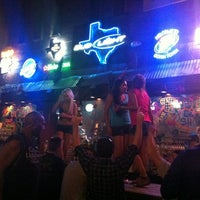 Photo taken at Coyote Ugly Saloon - San Antonio by Henrique Z. on 8/9/2012