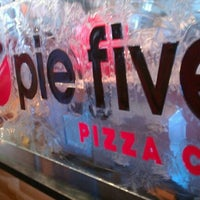Photo taken at Pie Five Pizza Co. by Andrea S. on 3/31/2012