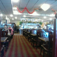 Photo taken at New China Buffet by Tiffany C. on 7/24/2012