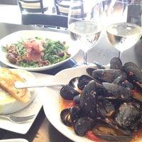 Photo taken at Coquine Restaurant by Jenna C. on 6/10/2012