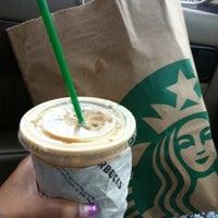 Photo taken at Starbucks by ดลยา บ. on 3/8/2012